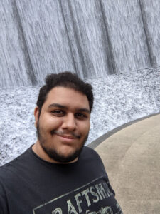 Picture of Aasim, one of the podcast hosts, smiling in a snowy landscape